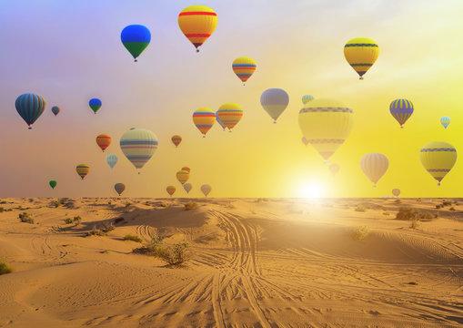 Hot air balloons sunset sand desert