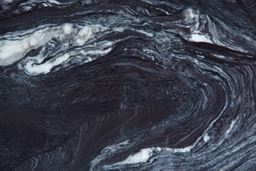 Canvas Prints Stunning light pattern on a dark natural stone, which is called quartzite Rosso Luana