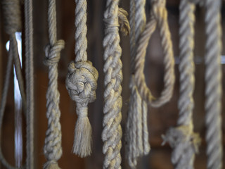 Traditionally made rope hanging from ancient pegs
