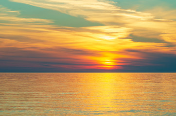 Zelfklevend Fotobehang Diepbruine sunset on the sea