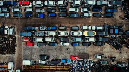 Damaged cars waiting in a scrapyard to be recycled or used for spare parts