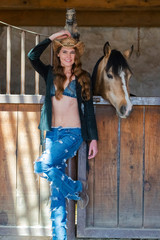 A Lovely Hispanic Brunette Model Poses With A Horse Outdoors In A Home Environment