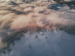 Aerial view of a sunset above the cloud