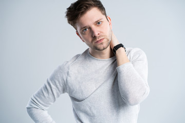 Good looking guy in white t-shirt, portrait.