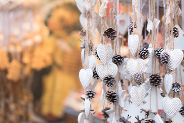 a detail of hand painted white hearts into the traditional Christmas Markets in South Tyrol, Bolzano province, Trentino Alto Adige, Italy