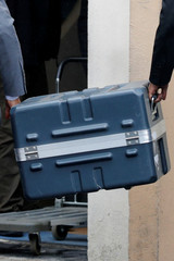 Men unload a case containing the black boxes from the crashed Ethiopian Airlines Boeing 737 MAX 8 outside the headquarters of France's BEA air accident investigation agency in Le Bourget