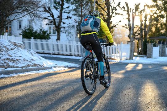 Winter Cyclist In The Sun