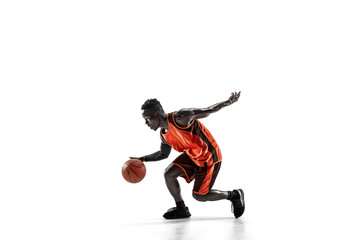 Full length portrait of a basketball player with a ball isolated on white studio background. advertising concept. Fit african anerican athlete with ball. Motion, activity, movement concepts.