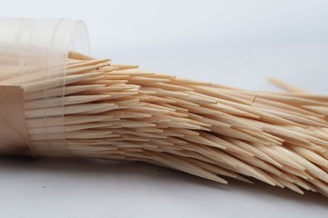 A toothpick in a dozen on a white background