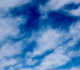The white clouds and the blue of the skies.