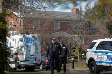 NYPD officers investigate the scene where reported New York Mafia Gambino family crime boss was killed, in New York