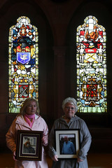 Linda Nash holds a picture of her relative, after the announcement of the decision whether to charge soldiers involved in the Bloody Sunday events, in Londonderry