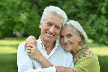 Portrait of mature couple in summer park