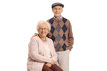 Senior couple posing and smiling at the camera
