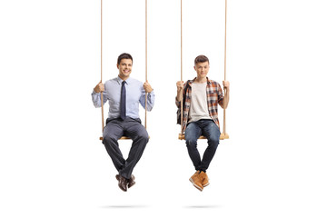 Teenage male student and a young man sitting on a swing