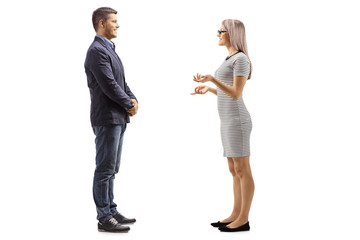 Young man and woman standing and having a conversation