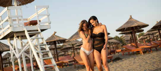 Pretty young women relaxing on the sandy beach