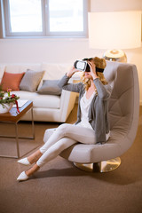 Pretty young woman wearing virtual reality goggles