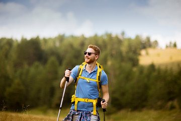 Young hiker enjoys a sunny day on the mountain