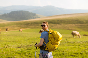 Handsome young red hair man hiking