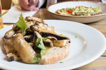 Healty vegan dishes of mushrooms on toast and avocado on toast