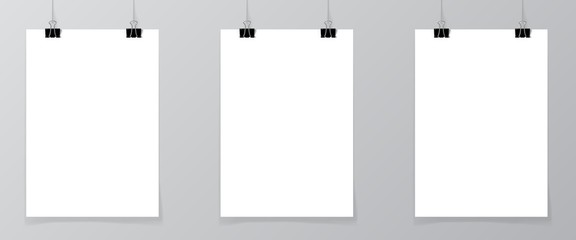 Set of 3 blank posters hanging on thread with clips