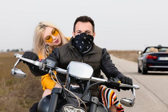 Beautiful young couple traveling Motorbike