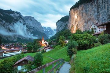Amazing touristic alpine village with famous church and Staubbach waterfall, Lauterbrunnen, Switzerland, Europe