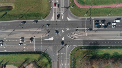 Highway intersection with cars and traffic lights. Top view from drone