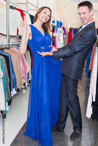 1d938fe161 Family couple posing together in clothes shop