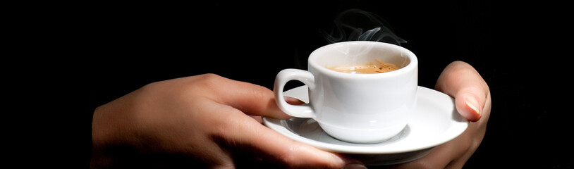 Woman's Hands holding a cup of coffee