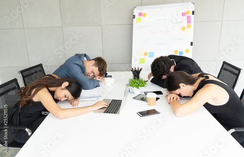 Group Of Business People Exhausted Sleep In A Meeting