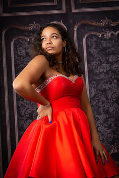 Beautiful,  Biracial High School Senior wearing red prom dress