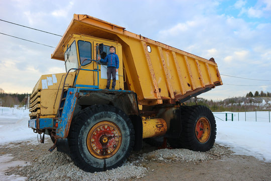 Young boy on the big yellow dump truck