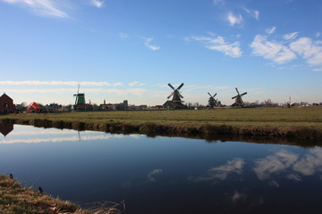 Dutch ancient windmill built from wood. typical structure of the Netherlands. old work tools on the river in the village of Zaanse Schans