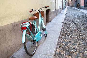 bicycle near house on medieval cobblestone street