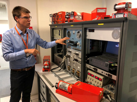 An official from FranceÕs BEA air crash investigation agency speaks near machines used to listen to tapes with that are recovered from black boxes during a press visit at their offices in Le Bourget