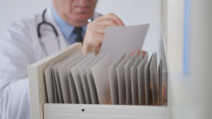 Doctor Image in a Hospital Office Writing in a Medical Document