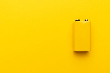 blank nine-volt battery on the yellow background with copy space Wall mural