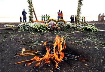 Candle flames burn during a commemoration ceremony for the victims at the scene of the Ethiopian Airlines Flight ET 302 plane crash, near the town Bishoftu