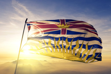 British Columbia province of Canada flag waving on the top sunrise mist fog Wall mural