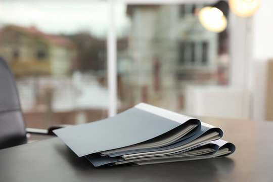 Stack of folders with documents on office table. Space for text