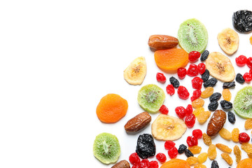 Different dried fruits on white background, top view. Healthy lifestyle