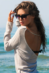 young beautiful woman portrait with sunglasses at sea beach summer