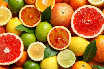 Different citrus fruits as background, top view Fototapete