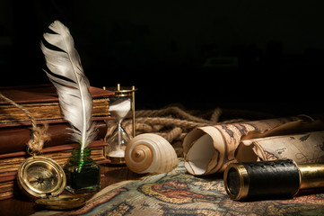 Vintage still life: old maps and vintage objects on a wooden table
