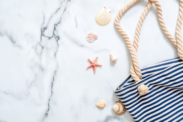 Summer holiday composition. Holiday accessories in flat lay style on a marble background. Mockup with copy space for your text.