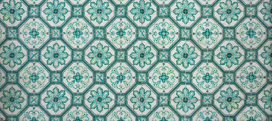 Ornate brightly colored portugese tile texture in green and white