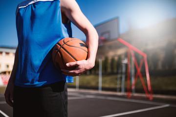 Basketball player holding ball,sport concept