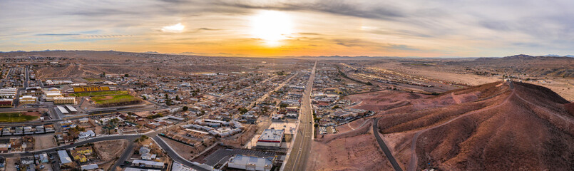 Aerial view of Barstow community a residential city of homes and commercial property community Mojave desert California USA at sunset
